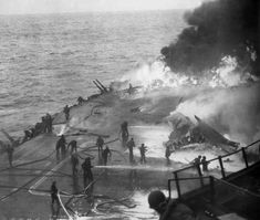 """he U.S. Navy aircraft carrier USS Saratoga (CV-3) burning after five """"Kamikaze"""" suicide planes hit the forward flight deck off Chi-chi Jima, shortly after 17:00h, 21 February 1945. Another attack at 19:00h scored an additional bomb hit. 123 of her crew were dead or missing as a result of the attacks."""
