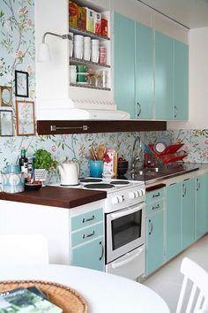 Floral Wallpaper In the Kitchen -not the usual color scheme.  Very fresh, I like it!