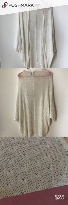 Flowy white cardigan This cardigan is extremely flowy and drapey. It's thick but has a lot of holes so it's very nice to wear during summer Forever 21 Sweaters Cardigans