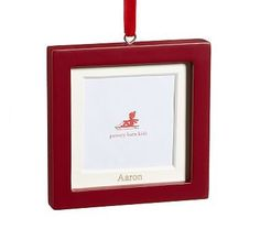 6e33e2745ae Tuck a favorite photo of your little one into a pretty red frame. Pottery  Barn Kids