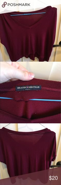 brandy mellville cropped red tshirt a SUPER soft cropped shirt. they don't sell this anymore so grab it while you can. it's got a hem that curves up and is loose. the neck is not very deep so no need to worry about the girls! Brandy Melville Tops Crop Tops