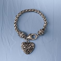 "HEART BRACELET    New for 2012, this JS Collection bracelet features a beautiful Jim Shore heart with a floral pattern on a chain with sparkling barrel beads and a heart lobster claw closure.    Specifications:  Size: 7""L  Materials: Lead-free, Glass Beads, Steel, Zinc alloy  Introduction: June 2012    Your Price: $22.00"