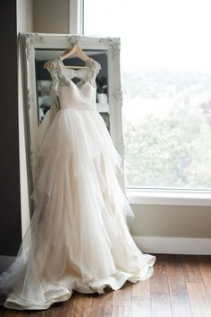 39 Getting-Ready Wedding Photos Every Bride Should Have: #11. Gorgeous bridal dress hung on a vintage mirror