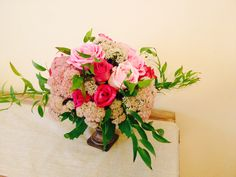 Romantic pink centerpiece in a bronze urn.   www.the-petal.com