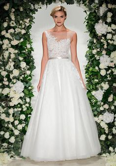 Bateau neckline gown with full A-line skirt of tulle with Chantilly and Alencon lace appliques | Anne Barge | https://www.theknot.com/fashion/cadogan-anne-barge-wedding-dress