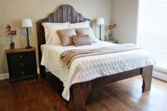 This DIY bed's rugged good looks come from its construction material -- repurposed deck wood.