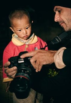 """Mesmerized    """"This was shot during the Yuanyang workshop earlier this year, one of our photographers is showing the image to the kid he has photographed. I caught that moment with my camera.    William""""  Chinaphotoworkshop.com    Amazing"""