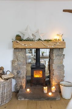Real home: a Victorian country cottage with simple Scandi-style interiors Cottage Fireplace, Home Fireplace, Living Room With Fireplace, Fireplace Design, Christmas Fireplace, Country Fireplace, Fireplaces, Double Sided Fireplace, Cottage Living Rooms