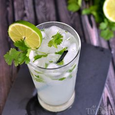 This Coconut Lime Cilantro Cooler is the perfect cocktail for summer!   MomOnTimeout.com