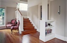 A column set over an open bookcase that suggests a division between the living room and entry hall.