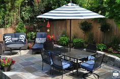 Stunning backyard patio redo on a steep hill