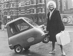 Smallest Portable Car?    Even smaller in scale, this mini-vehicle is practically luggage-sized! When your legs get cramped you can hop out and pull it the rest of the way.