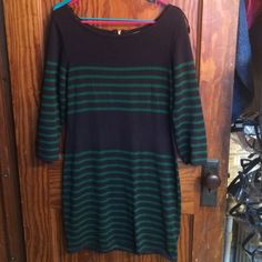 Michael kors sweater dress Great condition! And amazing flattering, comfy, sweater dress. I just don't wear it enough anymore. Navy blue and dark green colors with a gold zipper in the back. Goes to right above the knee. Michael Kors Dresses