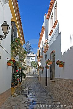 Photo about Narrow cobbled colourful back street with many flowers in Estepona Spain on the Costa del Sol. Image of narrow, peaceful, lights - 375342 Marbella Malaga, Marbella Spain, Places Around The World, Oh The Places You'll Go, Places To Visit, Spain Travel, Travel Europe, Make My Trip, Spanish Garden