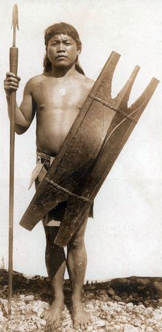 """Bontoc Igorot warrior (Philippines) with shield and spear,  early 20th century, the Bontoc Igorot, of the larger Malay people, are agriculturalists residing in the Northern Torrid Zone of the Philippine Archipelago. They are most well known for their past practice of head hunting, a cultural practice that was not uncommon in the region. Head hunting was traditionally seen as a pastime for men of the society; the Bontoc words for """"war"""" and """"head hunting"""" are interchangeable."""
