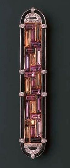 AN ART DECO DIAMOND AND GEM-SET BAR BROOCH, BY CARTIER  The central geometric panel of buff-topped amethyst, garnet, pink sapphire and citrines to the rose-cut diamond half-moon terminals within a border of elephant hair and diamond detail, late 1920s, 7.8 cm. wide Signed Cartier London, no. 7613