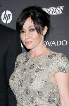 Shannen Dohertys updo hairstyle with bangs