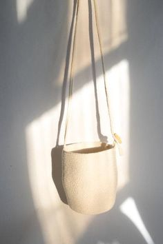 A modern, beautiful bag just in time for summer! This Bucket Bag is made of 100% cotton rope recycled from fabric production and has 6 strap adjustments. Specs: 6 strap adjustments 25 strap drop 8 tall 8 diameter 1-2 Week Lead time, some orders may ship sooner