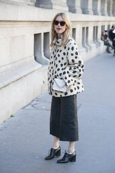 Street style mainstay Pernille Teisbaek opted for the quietly cheeky charms of a spotted Acne coat