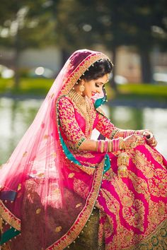 This bride looks so elegant in her pink bridal lehenga! We love the added detail of the contrast color for a great pop of color! Indian Bridal Wear, Pakistani Bridal, Bride Indian, Indian Weddings, Hindu Weddings, Bollywood, Hindu Girl, Bridal Outfits, Bridal Dresses