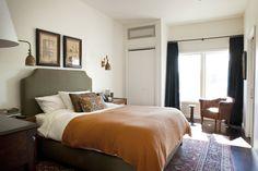 brass sconces in chic bedroom by Schuyler Samperton Interior Design