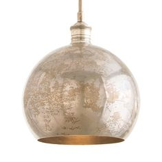 """This one-light vintage silver dome pendant looks great when hung in a row over an island, counter or table. As a single pendant it is perfect in a narrow staircase, where it looks as good from the top as it does from the bottom. This finish will continue to age and darken, resulting in a unique patina finish. Packed with (1) 6"""" and (2) 12"""" pipes.  Material: Brass Finish: Vintage Silver"""