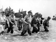 General Douglas MacArthur walking in the ocean towards the Beach WWII