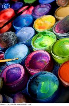 rainbow of artist paint pots