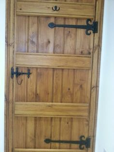 Rustic door with iron latch and hinges
