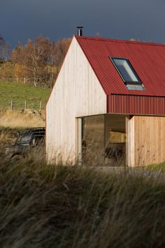 Moxon adds red metal and larch extension to Scottish Highlands farmhouse