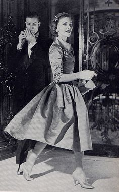 Vogue 1955/// Love the way this full skirt billows softly as she walks...I wonder what color this dress is....looks stiff, like taffeta....