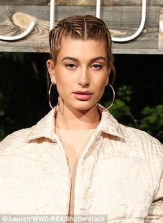 Crushing it: Hailey looked fashion savvy in a pair of suede chinos and a bomber style jack...