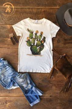 - Prickly pear cactus graphic tee - Hand painted original design - Ivory tee with earth tone graphics - Modern vintage destroyed neckline, sleeves, and hemline - 100% cotton, does not ball up with wea i had this tshirt