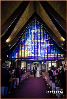 Bride walking down the aisle at Saint Hugh Catholic Church. It has amazing stained glass windows.  #CoconutGrove #Miami #wedding #ceremony