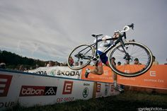 Lars van der Haar lifts his disc brake bike on the barrier. Proceed to podium #1 ...thank you! ★   CX WC Tabor 26-10-13 》cyclephotos.co.uk