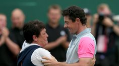 Northern Ireland's Rory McIlroy celebrates with his mother Rosie on the 18th green