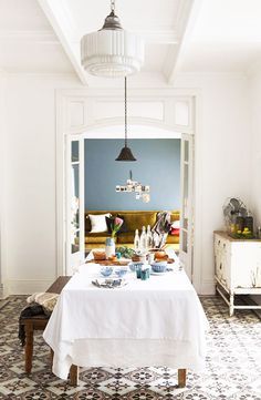 Dining benches in eclectic dining room via @thouswellblog