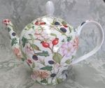 A mixture of flowers and berries is featured on this Fine bone china teapot . Made In Stoke on Trent, Staffordshire, England by Crown Trent. Approx 36 oz capacity. Hand Decorated in chintz motif.Has Filter holes inside spout Limited Quantites,