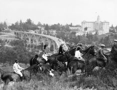 (Early 1930s)* - Photo of horseback riders in the Arroyo Seco, overlooking the Colorado Street Bridge. The Vista Del Arroyo Hotel is on the right.	  Water and Power Associates