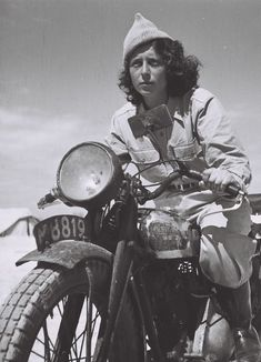 Droroa Harehuveni, a young Haganah dispatcher, rides her motorcycle, 1948.