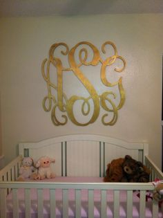 Baby girl nursery, oversized gold monogram