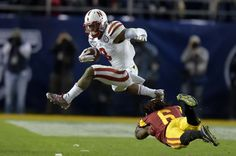 USC nips Huskers in bowl game