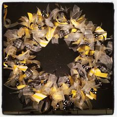 Ribbon wreath. Simply tie ribbon to wire wreath frame, easy!