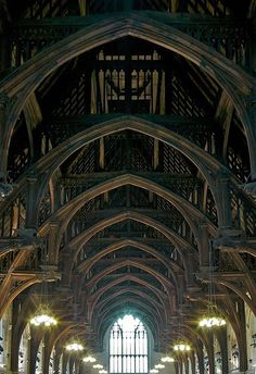 "The Angel Roof at Westminster Hall (looking East), Westminster, London, England http://www.castlesandmanorhouses.com/photos.htm ... The Angel Roof at Westminster Hall is a hammerbeam roof built by Hugh Herland for Richard II mainly between 1395-8. A hammerbeam roof is a decorative, open timber roof truss typical of English Gothic architecture and has been called ""...the most spectacular endeavour of the English Medieval carpenter."""