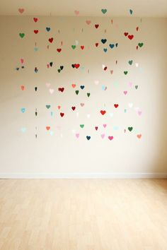 Valentines Day DIY hearts. Using construction paper and clear fishing wire, hang from ceiling
