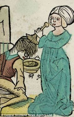 500-year-old illustrated medical book on dispaly at University of Aberdeen, UK (Pict. a woman removing headlice from a young boy)