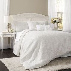 """Highlighted by delicate floral embroidery, this elegant comforter set outfits your bed in inviting style.    Product: Queen: 1 Comforter and 2 shamsKing: 1 Comforter and 2 shams  Construction Material: PolyesterColor: White  Dimensions: Standard Sham: 20"""" x 26"""" Queen Comforter: 96"""" x 92""""King Sham: 20"""" x 36"""" King Comforter: 110"""" x 96""""  Note: Shams do not include inserts   Cleaning and Care: Dry clean only"""