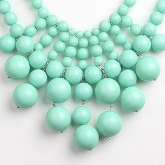 This mint green bib necklace by Ruby Jewelry is perfect for adding a pop of color to any outfit!