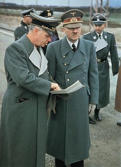 A rare color photograph of Joachim von Ribbentrop and Adolf Hitler. Otto Dietrich is visible