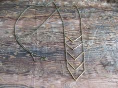 want this so bad. chevron necklace $35